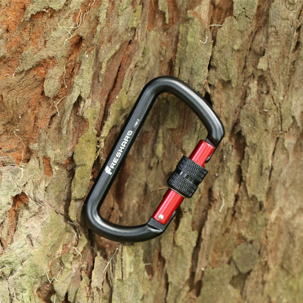 12kN Screw Locking Carabiner hanging on a tree
